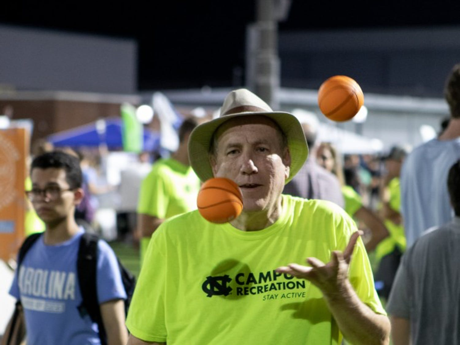 Bill Goa, Director of Campus Recreation, juggles during Fallfest on on Hooker Fields the evening of Sunday, August 18 2019.