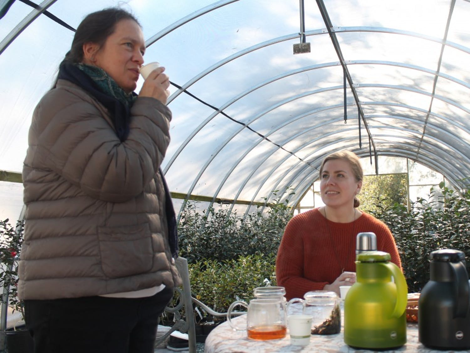 """(From left to right) Local artisan Christine Parks and photographer Kathy Hampton sample some of the tea they sold at the """"Meet the Makers"""" event held at Camellia Forest Nursery on Saturday, Nov. 17, 2018."""