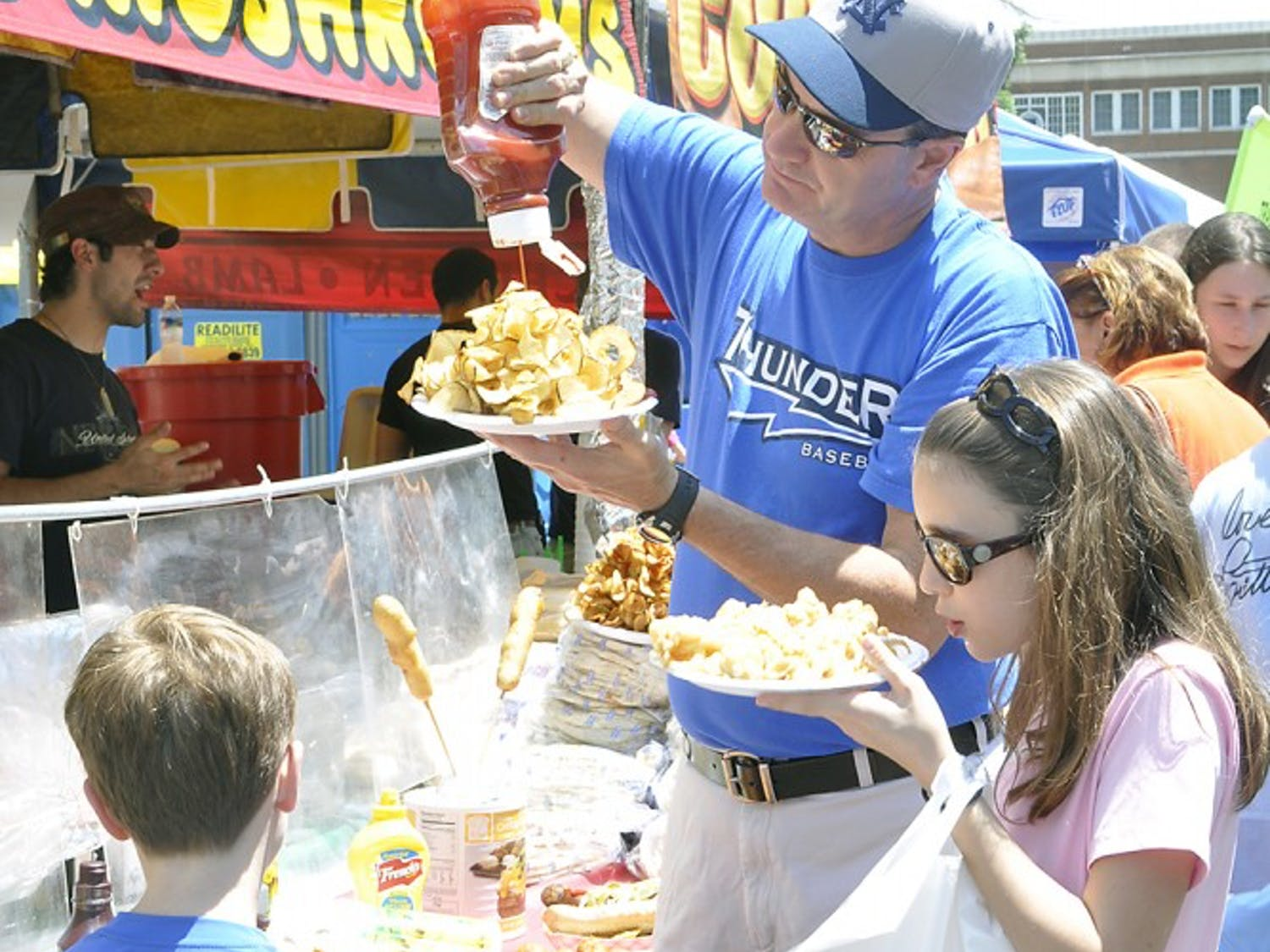 """UNC alumnus Chip Venable brings his kids, Preston and Hannah, to the festival every year. """"The kids really love it. They love the rides and the balloons and I like to have my barbecue,"""" Venable said."""