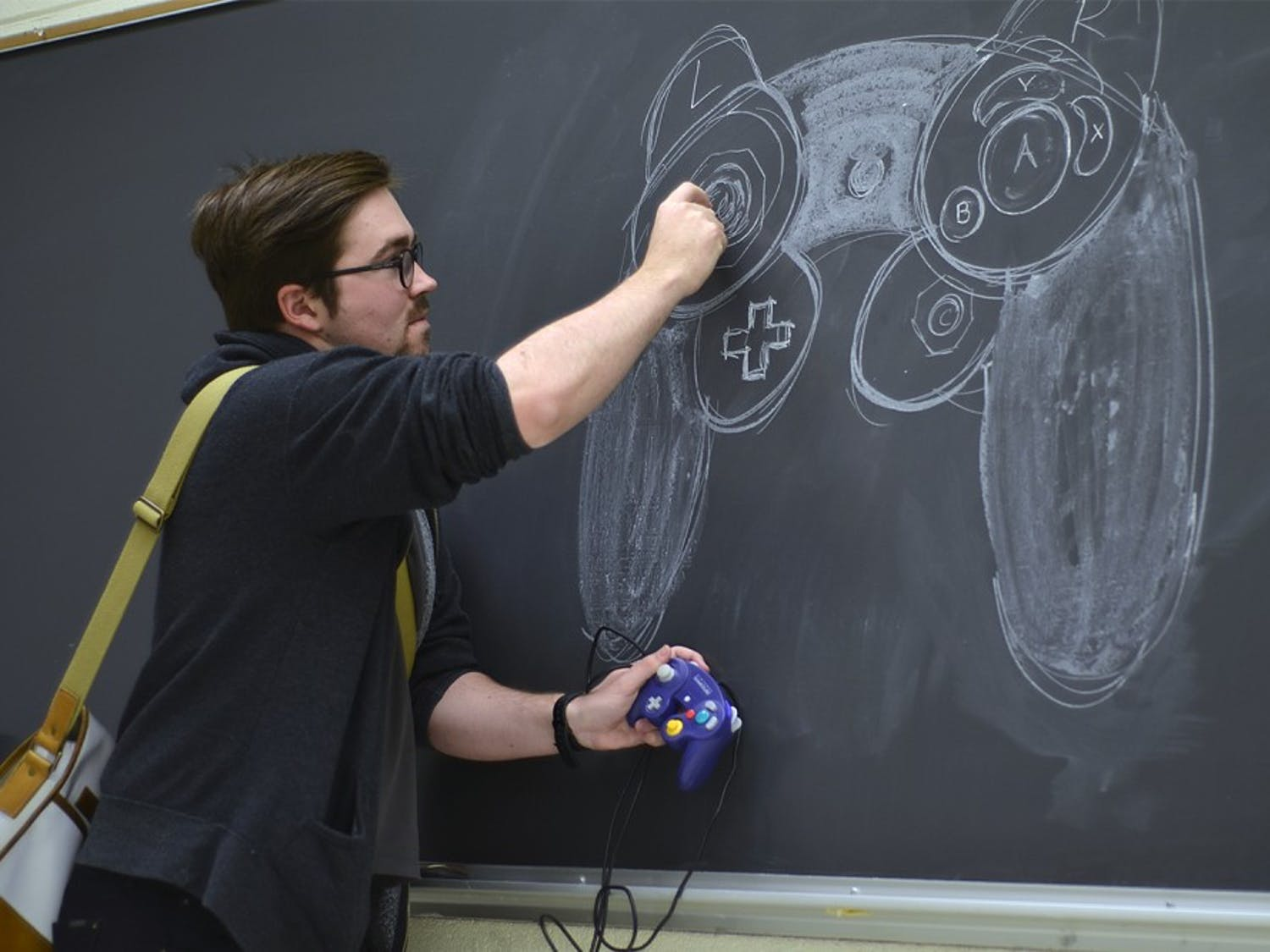 """Will Partin, a graduate student at UNC, is planning on teaching a new course, Press Play: the critical histories of video games, this summer. """"I believe video games are an important cultural artifact and university seminars are one of the best places to develop it. Video games are something people are interested in and I've always wanted to teach it."""""""