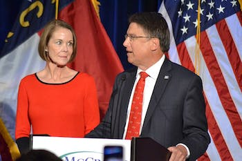 Governor Pat McCrory speaks with his wife during an election night party Wednesday at the Raleigh Marriot Crabtree Valley.