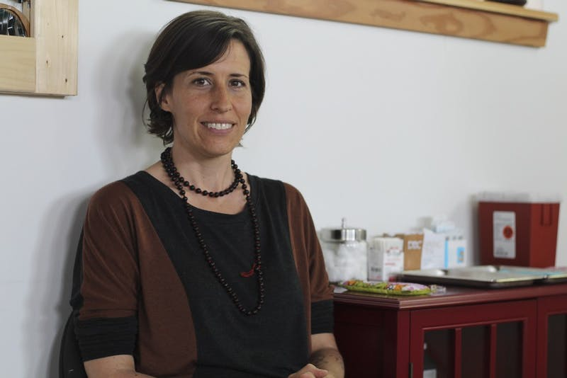 Kim Calandra, owner of Carrboro Community Acupuncture, sits in her office April 22, 2015. Calandra opened it in late 2014, and says she has strived to make the community a big part of the space.