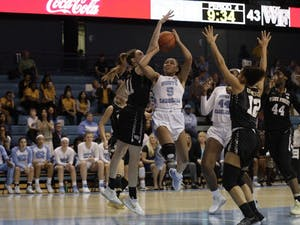 Junior guard Stephanie Watts (5) attempts to shoot a basket during a game against Wake Forest in Carmichael Arena on Thursday, Jan. 17, 2019. UNC won 84 to 61.