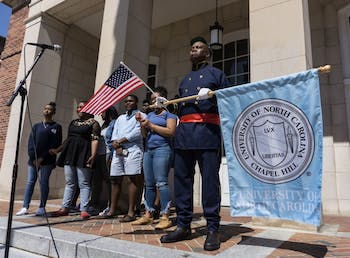 "William Thorpe, founder and director of UNC Walk for Health, spoke at the Peace and Justice Plaza in a Union Soldier outift Thursday, April 4, 2019.  ""We are gathered here today,"" Thorpe says, ""on the day of Martin Luther King Jr.'s assassination, to do a musical tribute to the causes he fought for.""  Thorpe led the UNC Gospel Choir in song and a march across McCorkle Place to the Old Well."