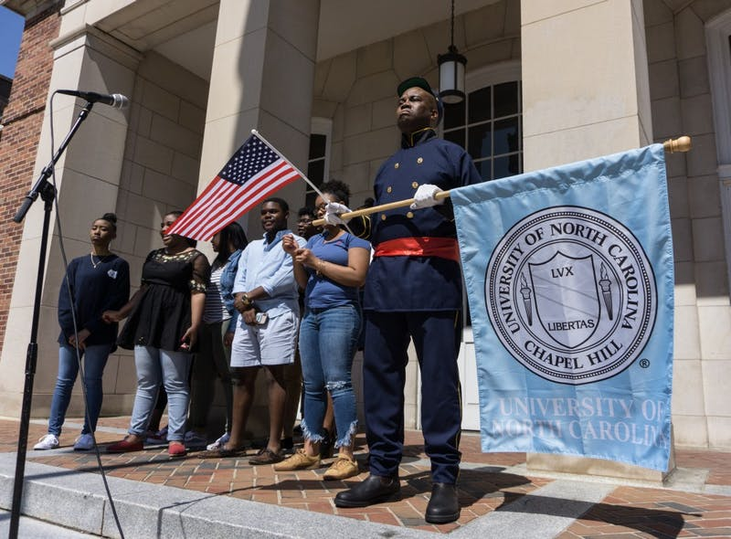 """William Thorpe, founder and director of UNC Walk for Health, spoke at the Peace and Justice Plaza in a Union Soldier outift Thursday, April 4, 2019.  """"We are gathered here today,"""" Thorpe says, """"on the day of Martin Luther King Jr.'s assassination, to do a musical tribute to the causes he fought for.""""  Thorpe led the UNC Gospel Choir in song and a march across McCorkle Place to the Old Well."""
