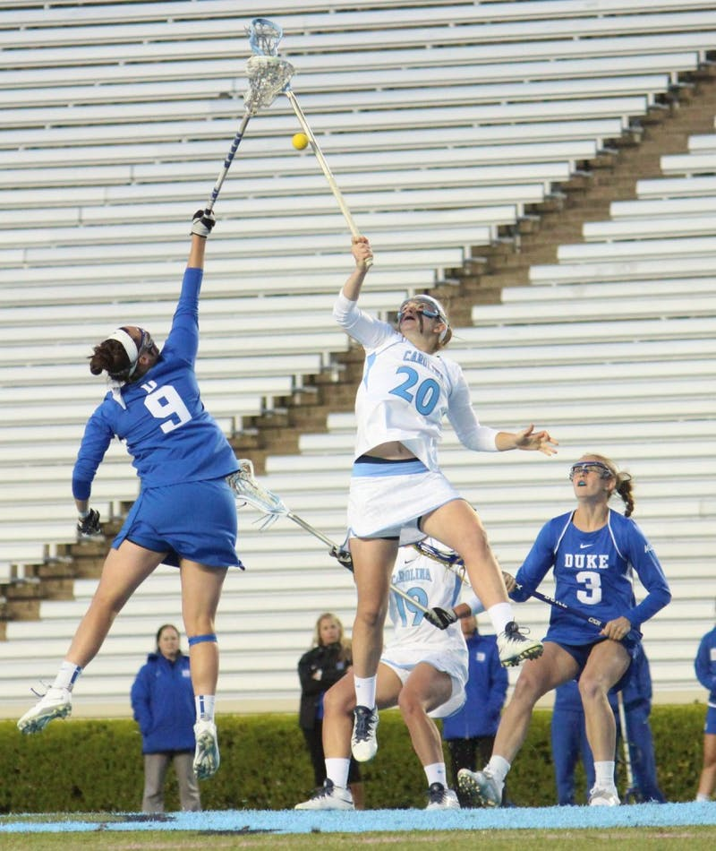 Women's lacrosse suffers a loss 7-6 to Duke in overtime on Wednesday in Kenan Stadium. Molly Hendrick (20) faces off in the first half.