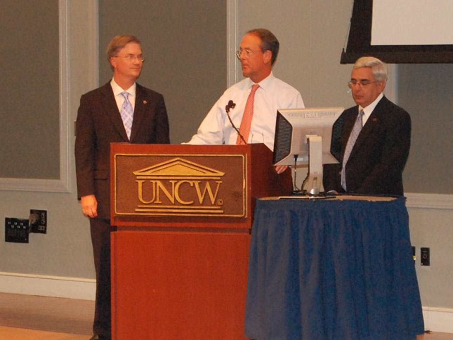 Chancellor Holden Thorp, UNC-system President Erskine Bowles and  athletic director Dick Baddour speak to the Board of Governors Thursday.