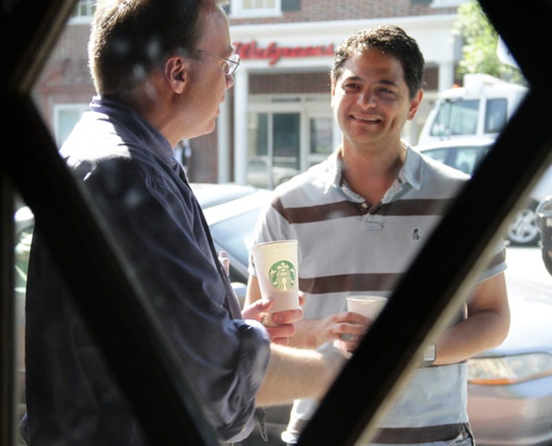 Chapel Hill Mayor Mark Kleinschmidt discussed the issue of alternative transportation with Carl Schuler, of UNC Hospitals, at the Starbucks on Franklin Street Wednesday. Kleinschmidt rode Chapel Hill Transit to talk to bus riders about the transportation system.