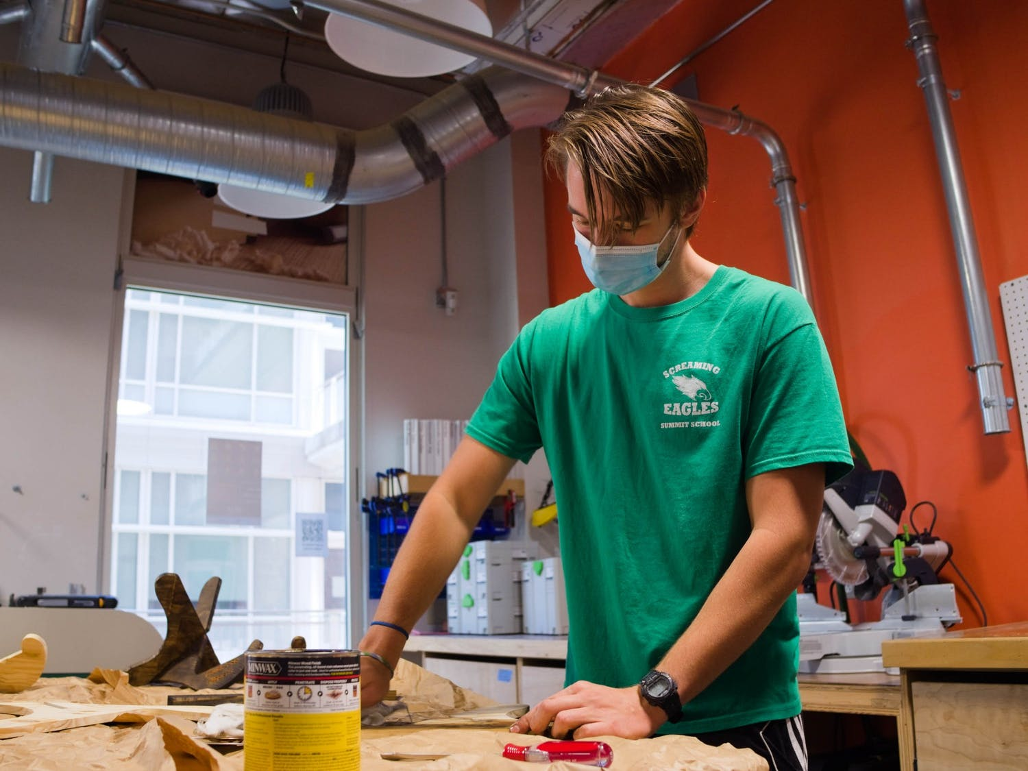 Junior Jimmy Toole finishes a wood piece for a guitar stand in the Murray Makerspace on Saturday, Oct. 31, 2020.