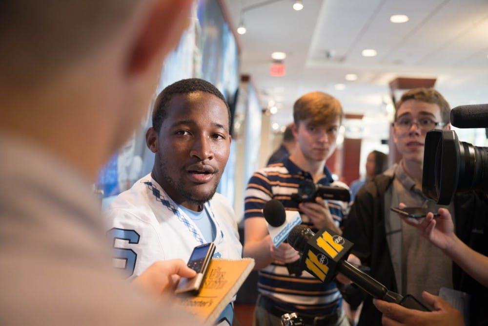 <p>Quarterback Brandon Harris talks to media at the North Carolina football team's media day in Kenan Stadium on Monday</p>