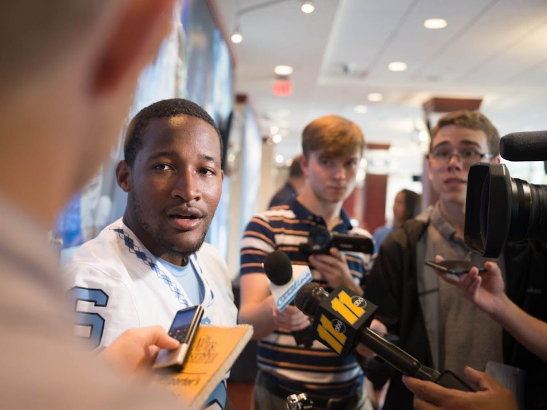Quarterback Brandon Harris talks to media at the North Carolina football team's media day in Kenan Stadium on Monday