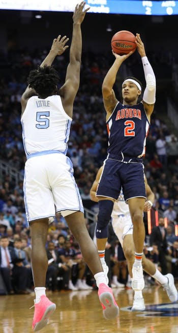 UNC first-year forward Nassir Little (5) guards Auburn senior guard Bryce Brown (2) during UNC's 97-80 loss against Auburn in the Sweet 16 of the NCAA Tournament on Friday, March 29, 2019 at the Sprint Center in Kansas City, M.O.