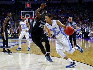 Marcus Paige drives towards the basket. Paige scored 12 points on Saturday night.