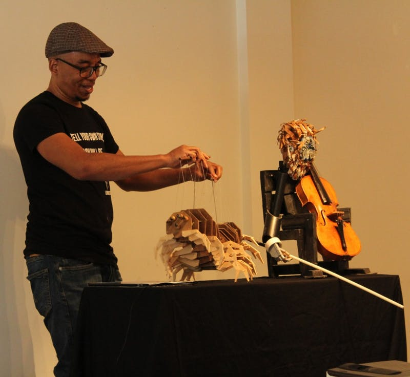 Tarish Pipkins, known as the master puppeteer Jeghetto, performs a puppet show at 109 E Franklin Street on Sunday, April 14, 2019. The pop up art gallery coincides with Arts Everywhere 2019.