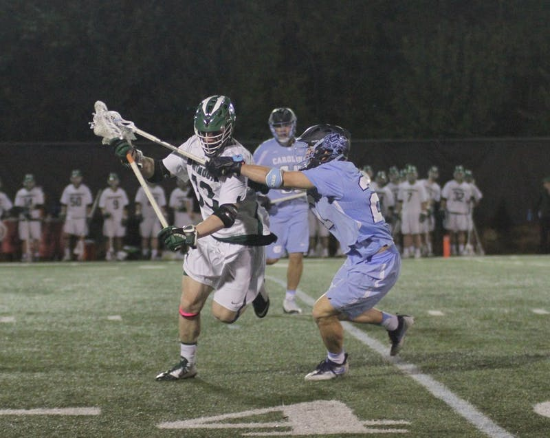 Michael Tagliaferri defends against Jack Richardson of Dartmouth.