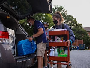 First year Miranda Darwin,  her mother Stacy and her father Ray load their car. Miranda, who previously had four in person classes before the switch to online classes was announced, moved out of Hinton James Residence Hall on Tuesday, Aug. 18, 2020.