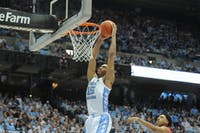 UNC forward Garrison Brooks (15) dunks during the game against Davidson in the Dean Dome on Saturday, Dec. 29, 2019. UNC won 82 - 60.