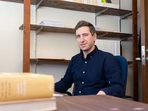 Max Lazar, a Jewish Ph.D. candidate in history and a program associate at UNC sits at the desk in his office in Hamilton Hall on Thursday, Jan. 9, 2020. Lazar is wary of listing Jews as a racial group amid the Trump administration's new interpretation of Judaism.