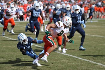 Miami wide receiver Braxton Berrios (8) breaks a tackle against North Carolina on Saturday in Kenan Stadium.