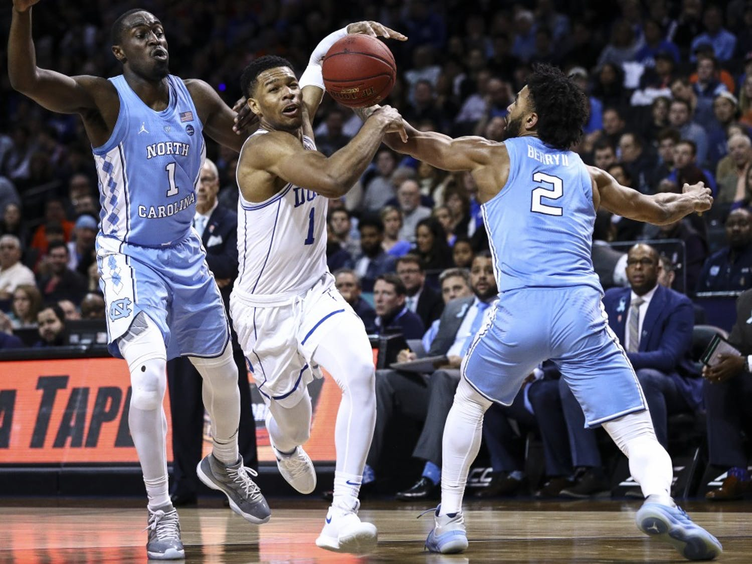 Theo Pinson (1) and Joel Berry II (2) strip the ball from Duke's Trevon Duval (1) during the ACC semifinals on March 9 in Brooklyn. Photo courtesy of David Welker, theACC.com.