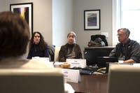 (From left) Ariana Vigil, Laurie McNeil and Secretary of the Faculty Vin Steponaitis, consider a point presented by Chair of the Faculty Leslie Cherise regarding a revision of the Chancellor Advisory Committee's charge during a meeting in South Building on Wednesday, March 20, 2019. The revision concerned the committee's power to nominate candidates for Secretary and Chair of the Faculty.