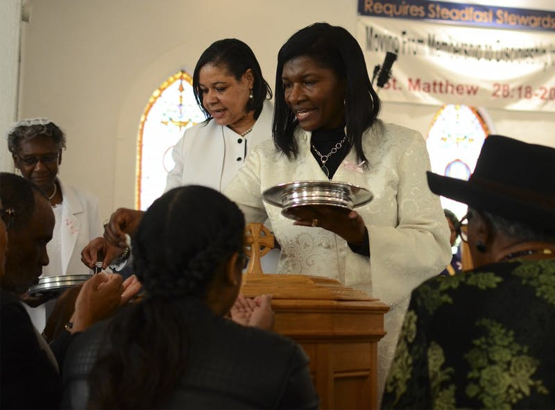 Rev. Beverly M. Solomon (left) and Rev. Mary Jane Palmer (right) lead communion at St. Paul African Episcopal Methodist Church in Chapel Hill.