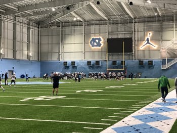 The UNC football team practices in its indoor football facility on Sunday, March 3, 2019.