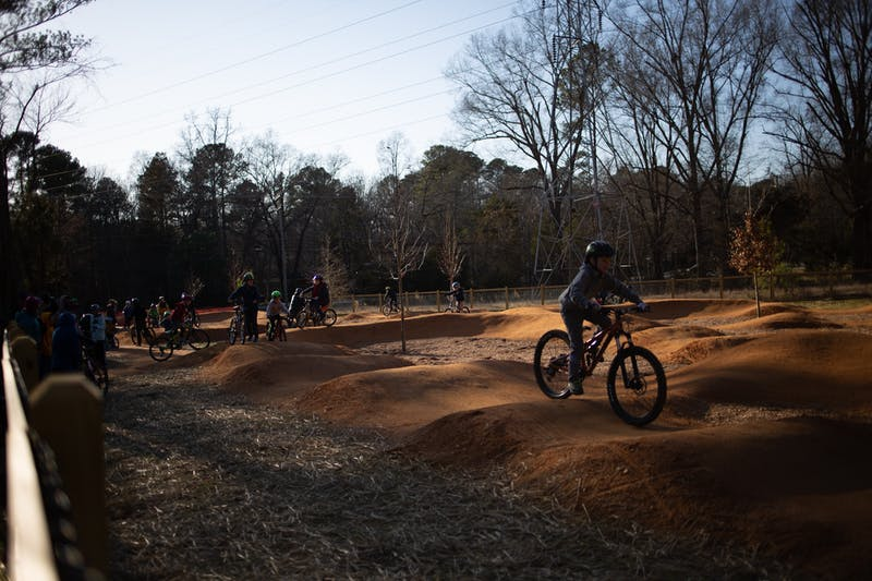 Bikers take on the track at the recently opened Martin Luther King Jr. Park on Monday, Jan. 20, 2020. Members of the community gathered for the park's ribbon-cutting two years after the initial groundbreaking.