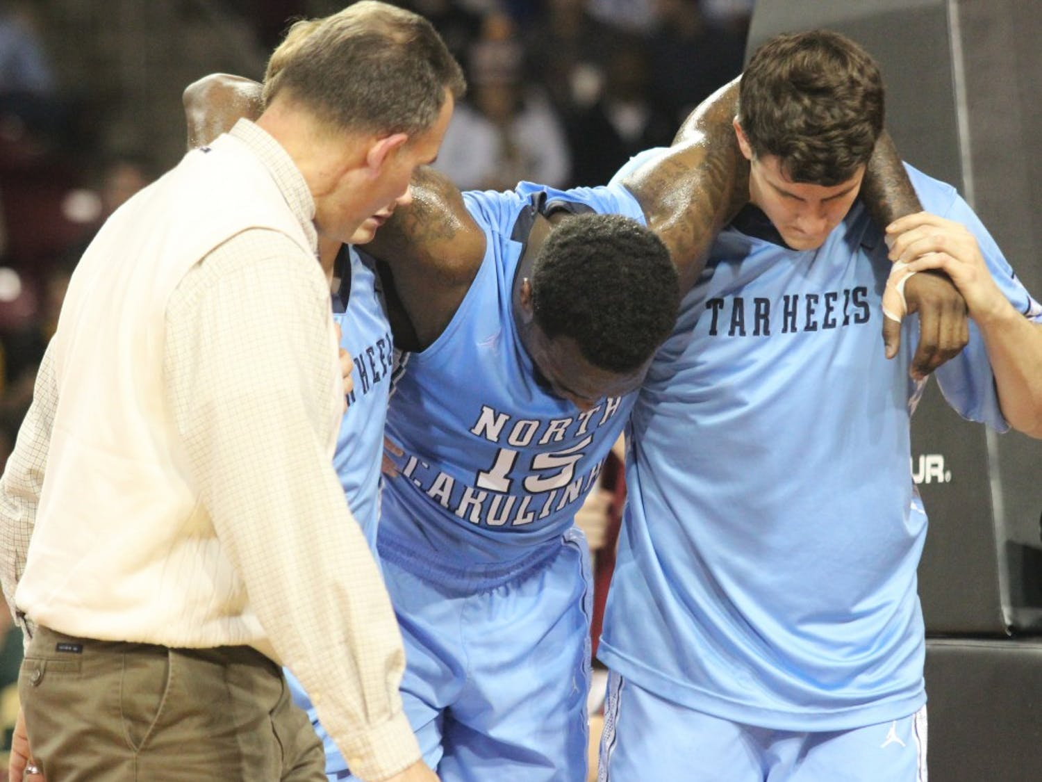P.J. Hairston leaves the court after his injury.
