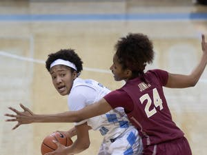 UNC freshman guard Kennedy Todd-Williams (3)  looks to pass the ball against Florida State junior guard Morgan Jones (24) on Thursday, Feb. 4, 2021. UNC fell to Florida State 61-51