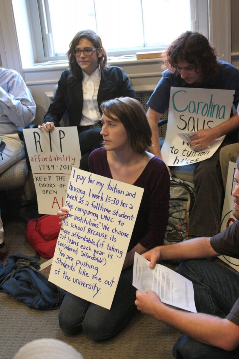The plans of raising tuition were discussed at South Building. The faculty proposed their plan and listened to Student Body President Mary Cooper's plan that was made with other students.