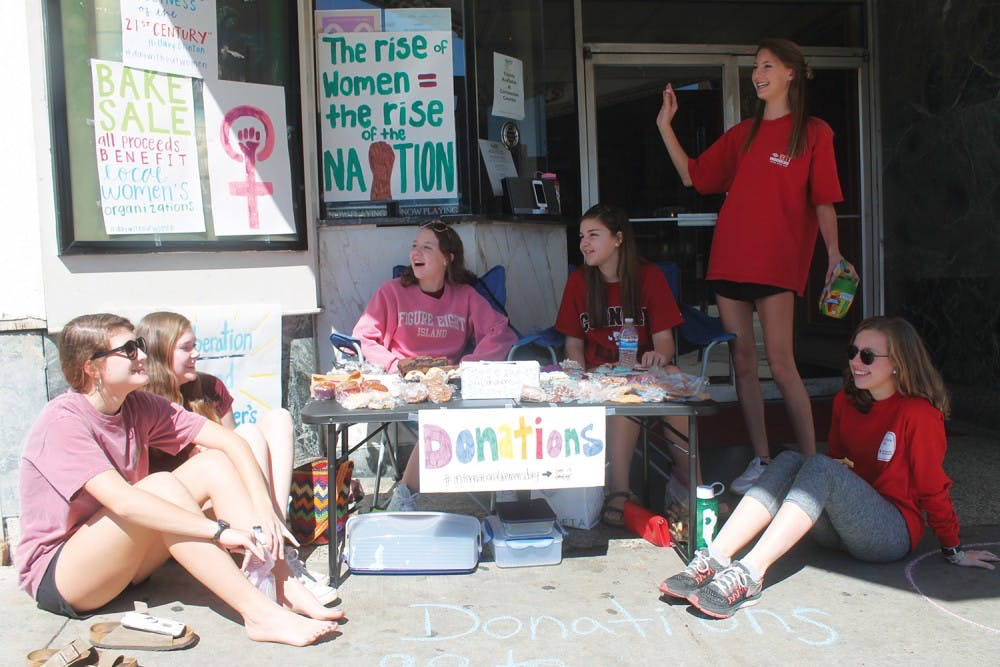 Local high school students host bake sales for women's organizations on International Women's Day