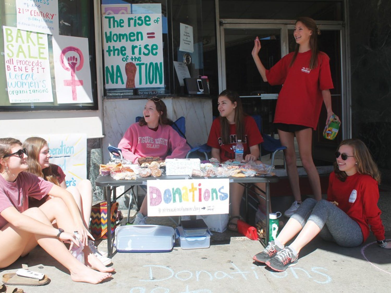 East Chapel Hill students Jillian Dialy (left), Emilie Apel, Carter Smith, Jillian Arleth, Elizabeth Head and Emmeline McManus sell cookies outside the Varsity Theatre.
