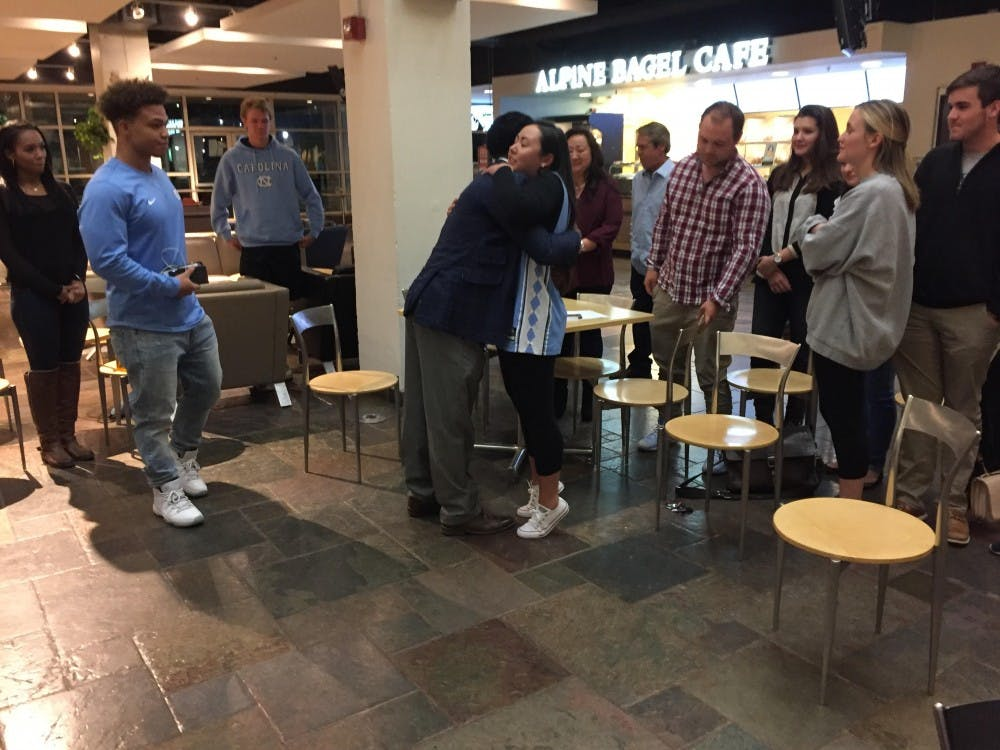 <p>Maurice Grier and Elizabeth Adkins embrace in the Student Union after Adkins was declared student body president on Friday night.&nbsp;</p>