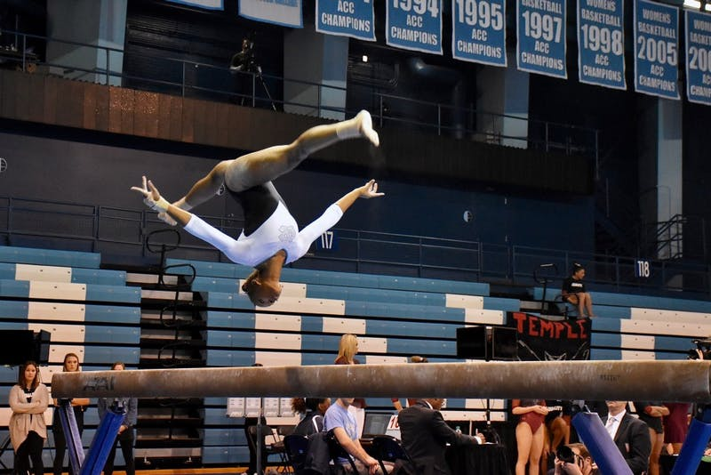 Khazia Hislop competes in the beam routine during a Jan. 19 meet against Temple.