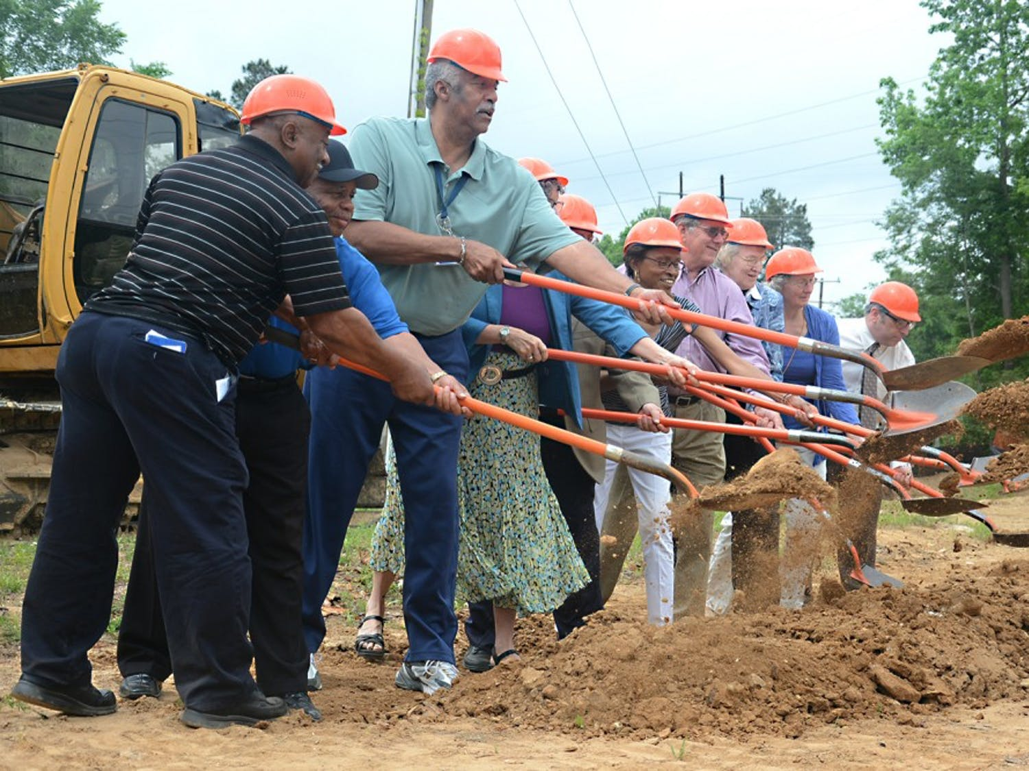 Leaders of the Orange County community break ground at the site of the new community building on Rogers Road.