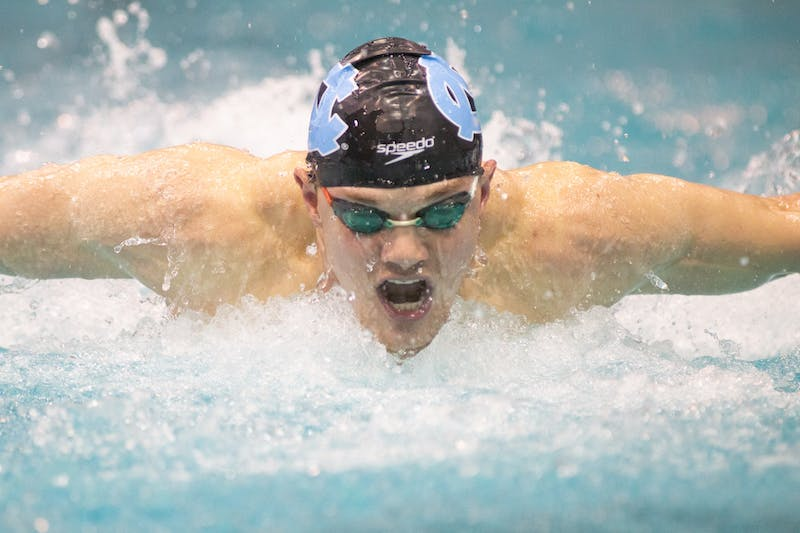 UNC junior swimmer Valdas Abaliksta competes in the 100-yard breaststroke event during a meet against Navy in the Koury Natatorium on Saturday, Jan. 11, 2019. The Tar Heel men's team beat the Midshipmen 160-140 and the women's team 163-131.