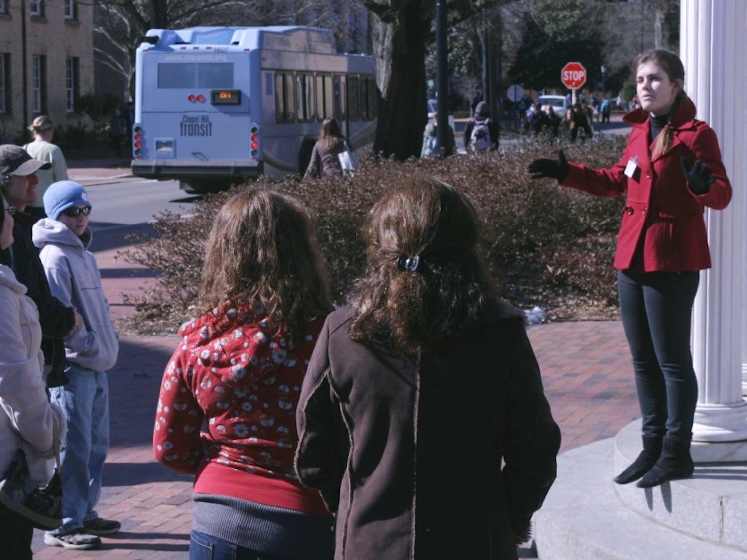 UNC student Ellen Porter leads a tour of the campus for prospective students and their families on Thursday morning.