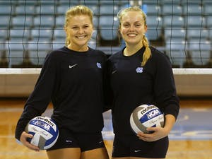 Jordyn Schnabl and Abigail Curry pose for a photo after practice Wednesday night.