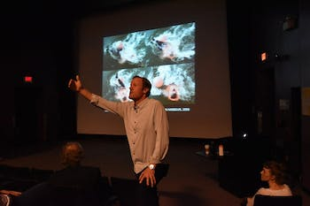 Craig Smith lectures students on Tuesday evening at Hanes Art Center.