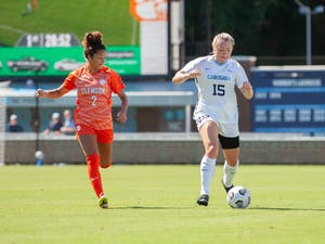 UNC sophomore forward Avery Patterson (15) protects possession of the ball during UNC's home matchup against Clemson at Dorrance Field on Sept. 26. UNC won 3-0.