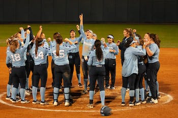 The UNC Softball team celebrates after a win against Campbell, 11-1. This was the team's first home game of the season, kicking them off with a 3-2 record.