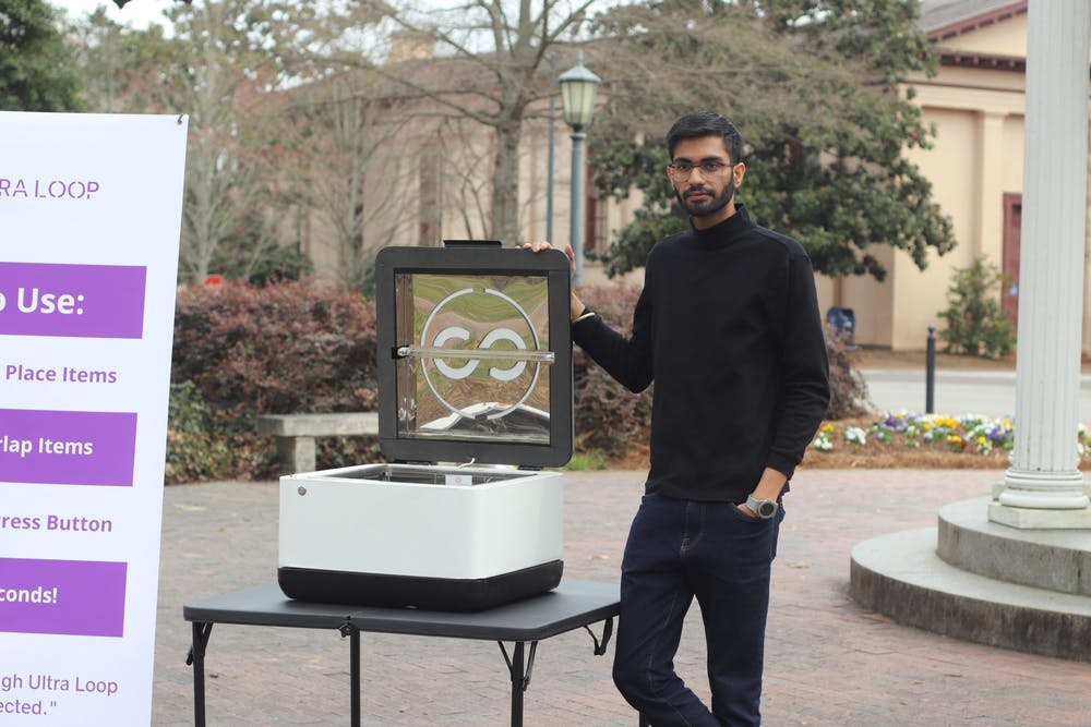 Aditya Bhatt, the Co-Founder & CEO Ultraloop Technologies, poses outside the Old Well with a sanitation device. Photo courtesy of Ultraloop Technologies.