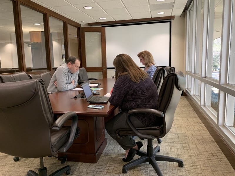 Members of the Campus Security Committee, including Heather Hummer and Edward Purchase, discuss Title IX and Clery Act recommendations for system campuses.