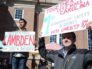 Students campaigning for  Will Lindsey and Christy Lambden in the pit . Jimmy Decker, right, who was Lambden's roommate for two years, is excited to support his friend in his campaign.