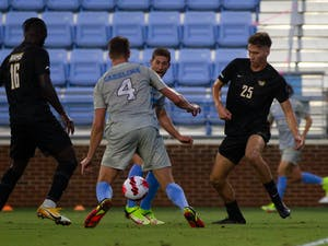 UNC graduate student defender Joe Pickering (4) gets control of the ball at the soccer game against Virginia Commonwealth on Aug. 29 in Chapel Hill. UNC tied 1-1.