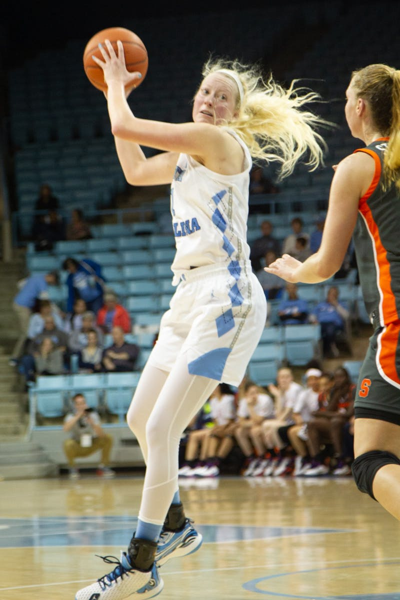 UNC senior guard Taylor Koenen (1) tries to pass the ball to teammate as Syracuse junior forward Digna Strautmane (45) guards during a game in Carmichael Arena on Thursday, Feb. 13, 2020. The Orange beat the Tar Heels 74-56.