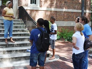 Junior Taylor Beckham, a classical civilizations major, guides a tour group of prospective students and parents around UNC.