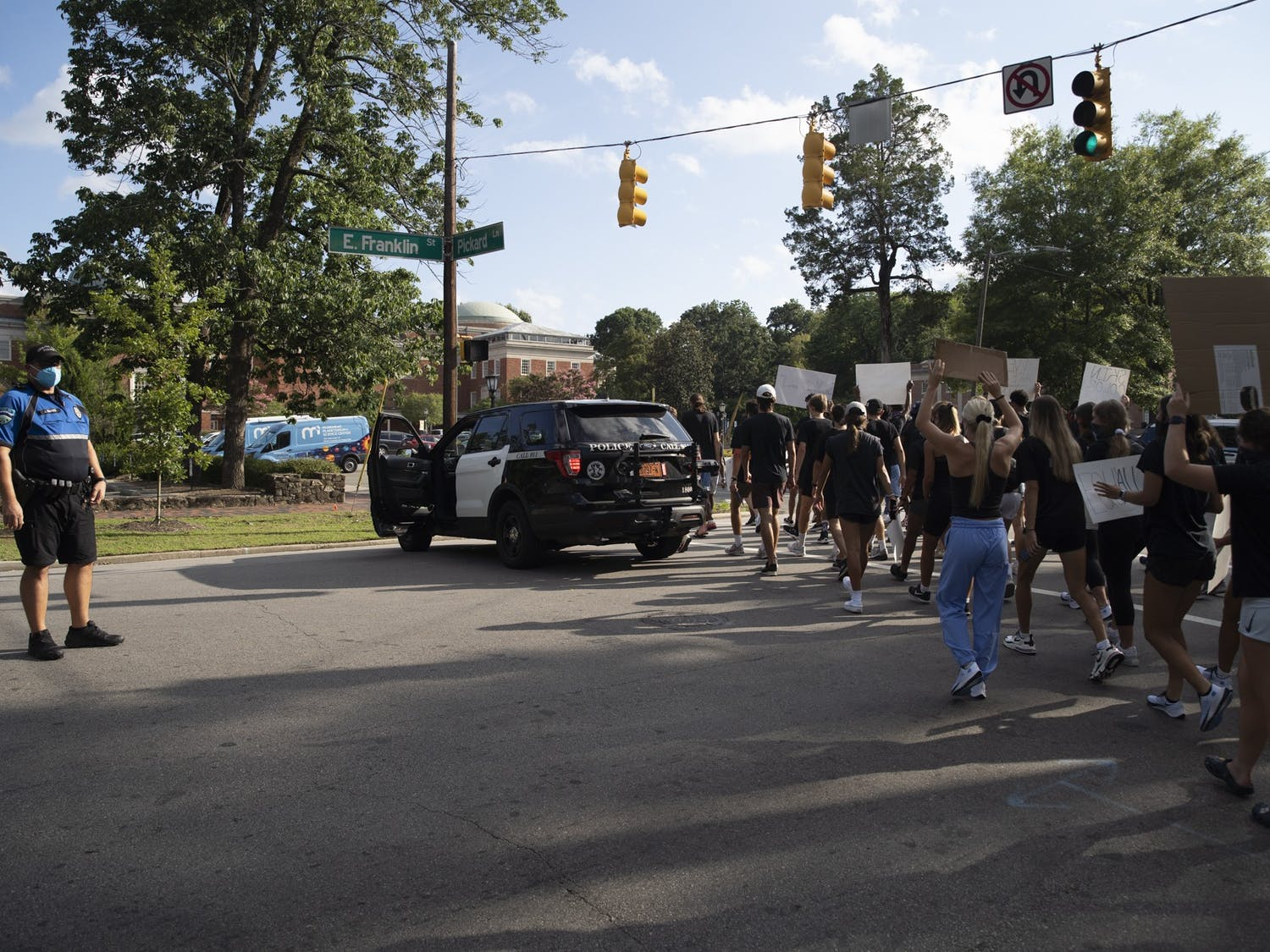 UNC athletes marched along Franklin Street to protest racial injustice on Aug. 29, 2020 in Chapel Hill, N.C. Athletes representing various UNC sports dressed in black, brought signs and called for the end of police brutality shortly after police shot Jacob Blake seven times in the back in Kenosha, Wis., on Aug. 23, 2020.