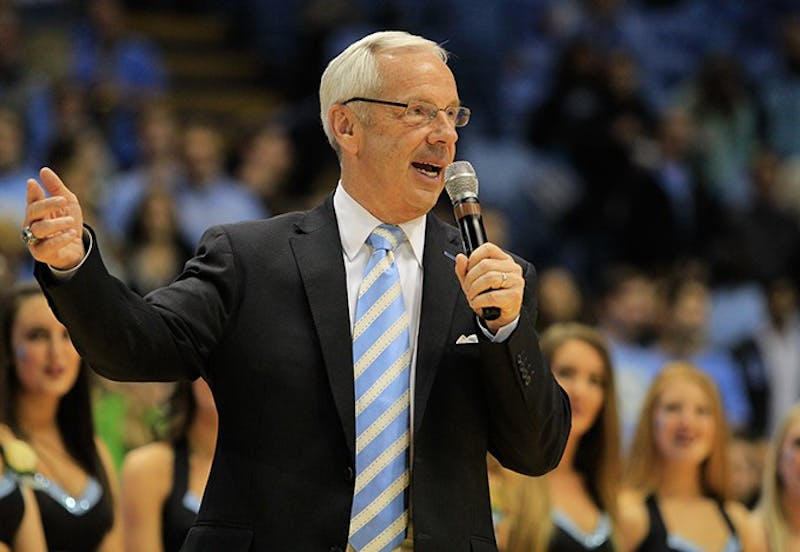Coach Roy Williams congratulated the seniors after the Tar Heels beat the Fighting Irish 63-61 Monday.